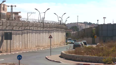 Cars-drive-along-the-new-West-Bank-Barrier-between-Israel-and-the-Palestinian-territories-1