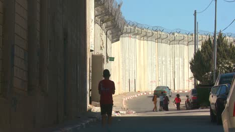 Children-walk-and-play-along-the-base-of-the-new-West-Bank-Barrier-between-Israel-and-the-Palestinian-territories