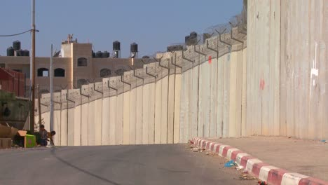 A-street-winds-along-the-base-of-the-new-West-Bank-Barrier-between-Israel-and-the-Palestinian-territories