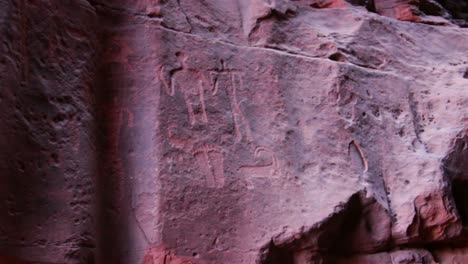 Ancient-and-mysterious-petroglyphs-adorn-the-walls-of-a-cave-in-the-Saudi-desert-near-Wadi-Rum-Jordan-1
