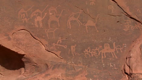 Ancient-and-mysterious-petroglyphs-depict-humans-and-camels-in-the-Saudi-desert-near-Wadi-Rum-Jordan