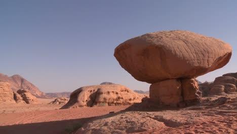 A-rock-shaped-like-a-mushroom-stands-in-the-Saudi-desert-near-Wadi-Rum-Jordan