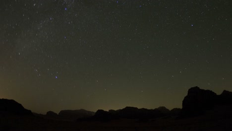 An-incredible-time-lapse-shot-looking-up-at-an-arch-formation-in-the-desert-against-a-night-sky-1