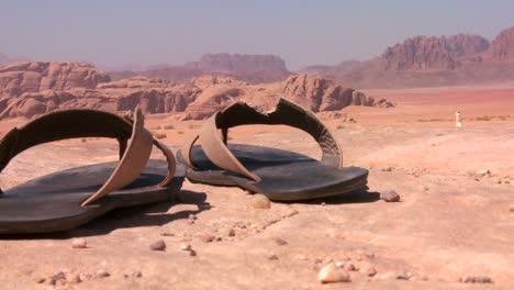 A-pair-of-well-worn-sandals-sits-in-the-Saudi-desert-of-Wadi-Rum-Jordan