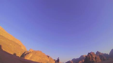 A-camel-train-passes-directly-over-the-camera-in-the-Saudi-desert-of-Wadi-Rum-Jordan
