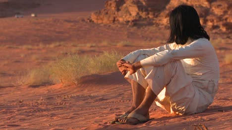 A-Bedouin-man-sits-and-contemplates-the-desert