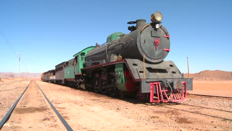 An-old-Turkish-steam-train-used-in-the-movie-Lawrence-of-Arabia-sits-in-the-Saudi-desert-of-Wadi-Rum-Jordan-1
