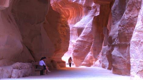 People-walk-through-the-narrow-canyons-leading-up-to-Petra-Jordan