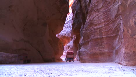 A-horsecart-passes-through-the-narrow-canyons-leading-up-to-Petra-Jordan