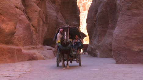A-horsecart-passes-through-the-narrow-canyons-leading-up-to-Petra-Jordan-1