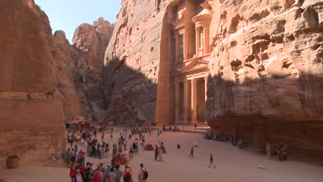 High-angle-view-of-the-facade-of-the-Treasury-building-in-the-ancient-Nabatean-ruins-of-Petra-Jordan-with-tourists