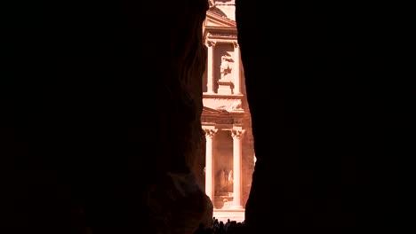 View-of-the-facade-of-the-Treasury-building-in-the-ancient-Nabatean-ruins-of-Petra-Jordan-through-the-narrow-canyon-entrance
