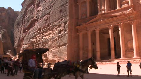 Camels-and-tourists-in-front-of-the-facade-of-the-Treasury-building-in-the-ancient-Nabatean-ruins-of-Petra-Jordan
