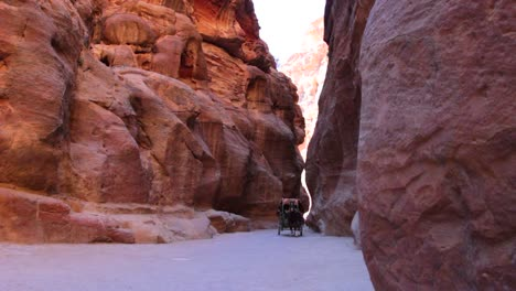 A-horsecart-passes-through-the-narrow-canyons-leading-up-to-Petra-in-Jordan