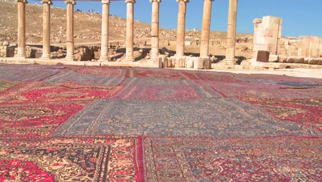 Pan-up-from-Arab-carpets-to-the-Roman-ruins-of-Jerash-in-Northern-Jordan