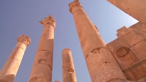 A-low-angle-shot-looking-up-at-pillars-in-the-Roman-city-of-Jerash-in-Jordan