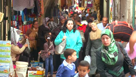 People-walk-in-the-Arab-Quarter-of-the-old-city-of-Jerusalem