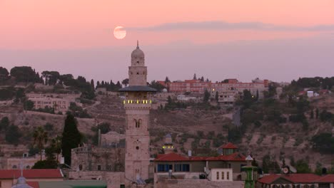 A-time-lapse-view-over-the-city-skyline-of-the-old-city-of-Jerusalem-with-the-moon-rising