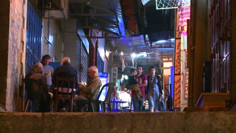 People-walk-in-the-Arab-Quarter-of-the-old-city-of-Jerusalem-at-night