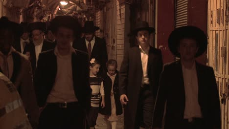 Hassidic-Jews-walk-in-the-Arab-Quarter-of-the-old-city-of-Jerusalem-at-night