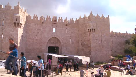 People-walk-out-of-the-Damascus-Gate-in-the-old-city-of-Jerusalem-