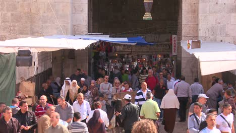 Crowds-of-people-walk-near-the-Damascus-Gate-in-the-Arab-Quarter-of-the-old-city-of-Jerusalem