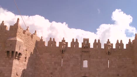 A-timelapse-shot-of-clouds-moving-over-the-gates-and-walls-of-the-Old-City-of-Jerusalem