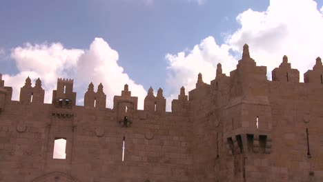 A-timelapse-shot-of-clouds-moving-over-the-gates-and-walls-of-the-Old-City-of-Jerusalem-1