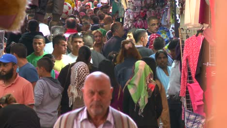 Crowds-of-people-walk-in-the-Arab-Quarter-of-the-old-city-of-Jerusalem