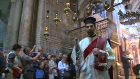 Greek-Orthodox-priests-perform-a-ritual-inside-the-Holy-Sepulcher-in-Jerusalem-Israel