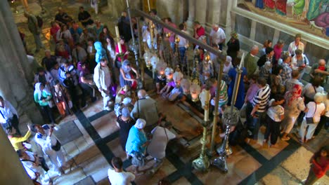 High-angle-over-the-holy-stone-which-marks-the-sport-Jesus-was-taken-down-from-the-cross-in-the-Holy-Sepulcher-in-Jerusalem-Israel