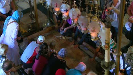 High-angle-over-the-holy-stone-which-marks-the-sport-Jesus-was-taken-down-from-the-cross-in-the-Holy-Sepulcher-in-Jerusalem-Israel-1