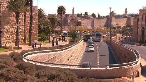 Traffic-moves-near-the-old-city-walls-of-Jerusalem-Israel