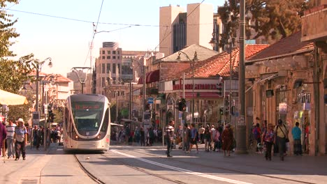 An-electric-tram-moves-through-the-new-city-of-Jerusalem-israel-1