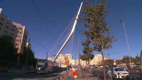 Traffic-moves-near-a-huge-bridge-in-the-form-of-a-harp-greets-visitors-in-the-new-city-of-Jerusalem-Israel