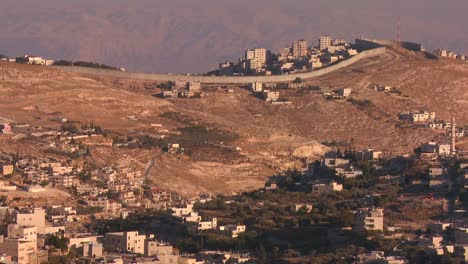 The-new-security-wall-marking-Israel-from-palestine-moves-across-the-distant-hills-of-Israel