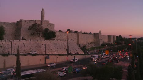 The-old-city-walls-of-Jerusalem-Israel-glow-in-dusk-light