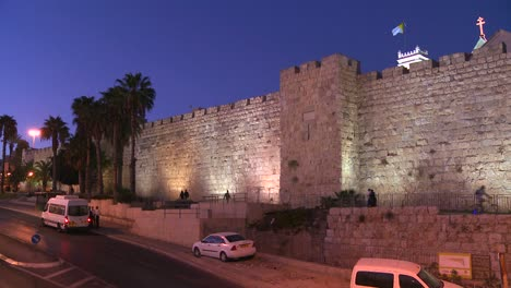 Traffic-moves-in-front-of-the-old-city-walls-of-Jerusalem-Israel-by-night