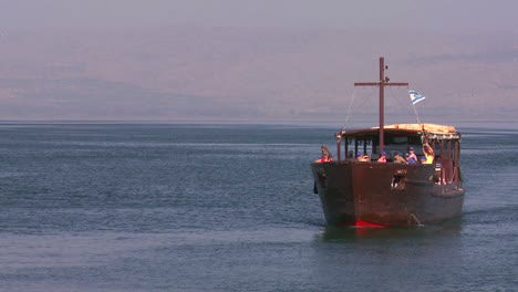 A-boat-bearing-Christian-pilgrims-travels-along-the-sea-of-Galilee-in-Israel