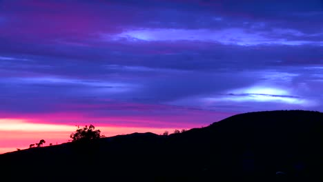 Time-lapse-of-a-silhouetted-hillside-from-just-after-sunset-to-early-evening