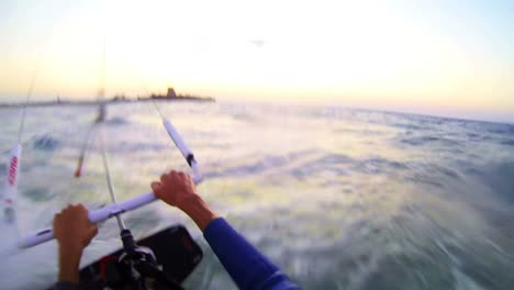 A-POV-shot-from-the-vantage-point-of-a-windsurfer-moving-across-waves