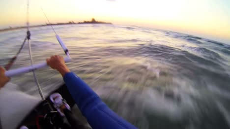 A-POV-shot-from-the-vantage-point-of-a-windsurfer-moving-across-waves-1