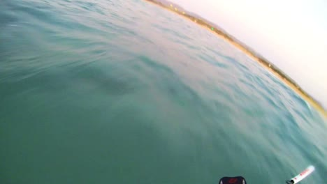 A-POV-shot-from-the-vantage-point-of-a-windsurfer-moving-across-waves-2