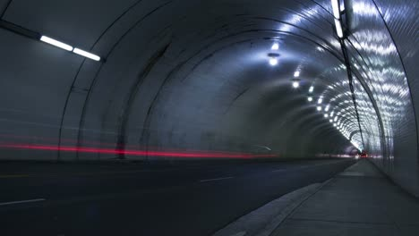 Time-lapse-shot-of-cars-passing-through-a-tunnel
