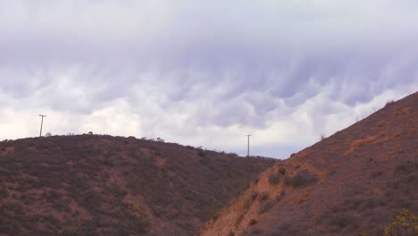 Scalloped-clouds-float-above-a-hillside-in-California
