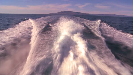 POV-from-the-back-of-a-boat-motoring-through-the-waters-off-Santa-Barbara-California