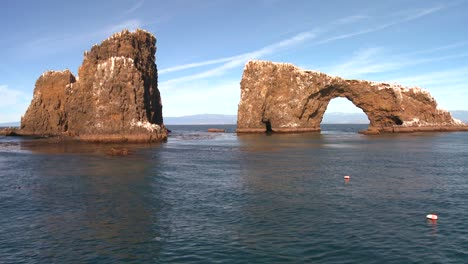 Anacapa-Islands-iconic-natural-bridge-and-nearby-islets-in-Channel-Islands-National-Park-as-seen-from-a-boat-just-offshore