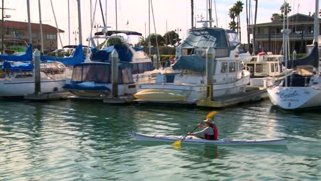 The-camera-tracks-a-kayaker-paddling-through-Santa-Barbara-Harbor