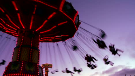 A-merry-go-round-spins-with-riders-against-the-sky-1