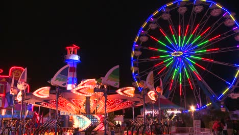 A-Ferris-wheel-an-rides-at-a-carnival-at-night